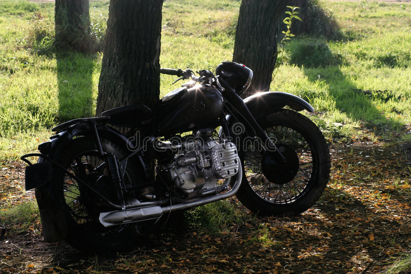 Motorcycle in the forest stock photography