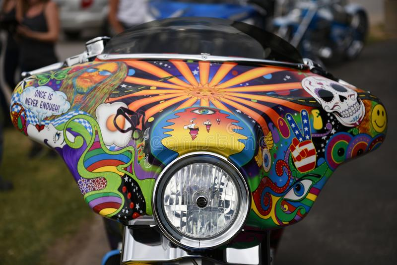 Motorcycle front end view of a colorful hippie art design. August 05 2017: Motorcycle front end view of a colorful hippie art design in Sturgis, South Dakota stock image