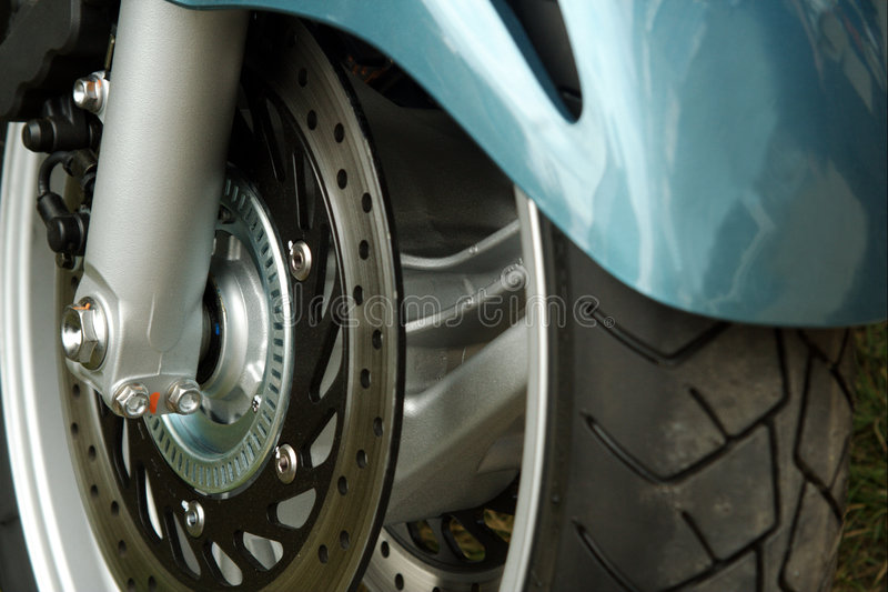 Motorcycle Front Wheel And Disc Brake Royalty Free Stock Photo