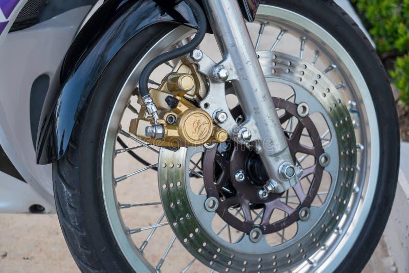 Motorcycle front wheel, tire, brake. Motorcycle front wheel, tire, disc brake stock photography