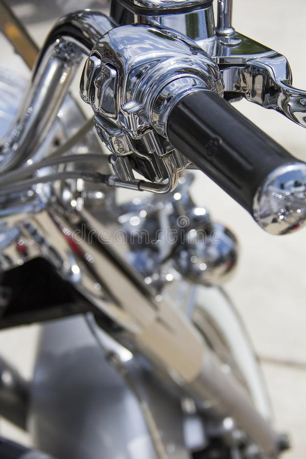 Motorcycle handle bars and throttle with lots of chrome royalty free stock photo