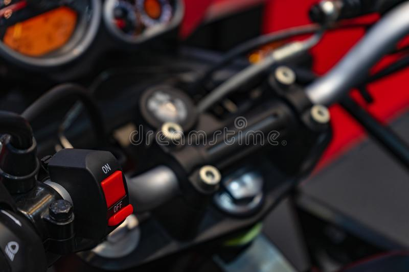 Motorcycle handlebar start stop system. Close up detail of racing motorcycle handlebar. Selective focus for background. Motorsport royalty free stock images