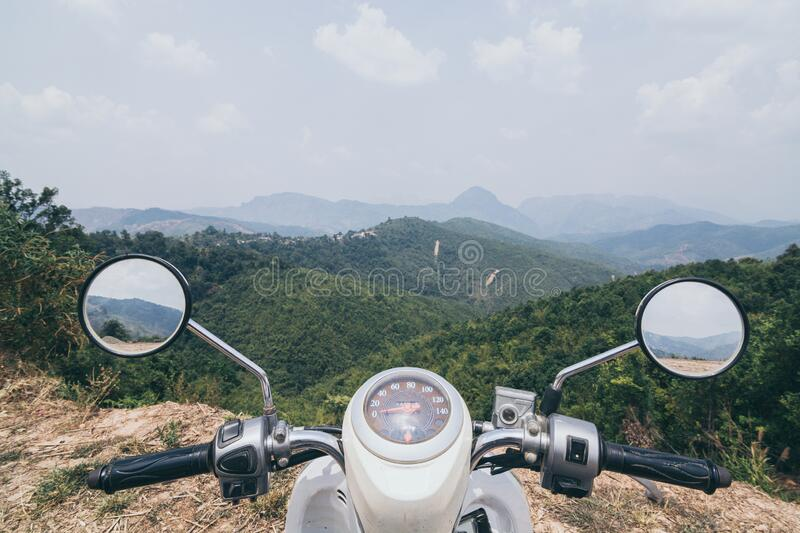Motorcycle handlebars with Laotian mountains on background. Close to Luang Prabang, mirror, riding, scooter, vehicle, laos, valley, viewpoint, overlooking stock photography