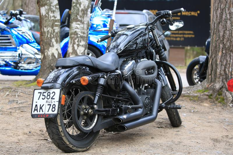 Motorcycle Harley Davidson Sportster 1200 black. Back view along right side. Time of opening of motoseason 2018. Komarovo. Resort area of the Saint-Petersburg royalty free stock photos