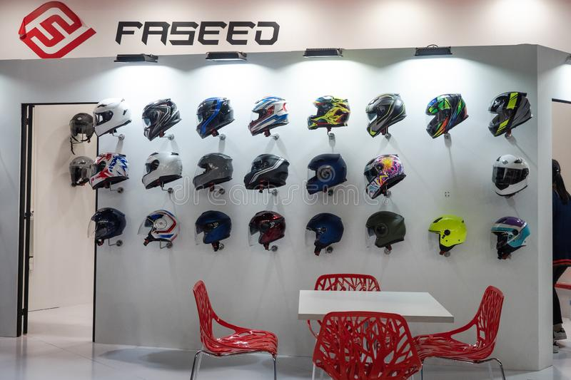 Motorcycle helmet display wall at EICMA Expo in Milan, Italy royalty free stock photo