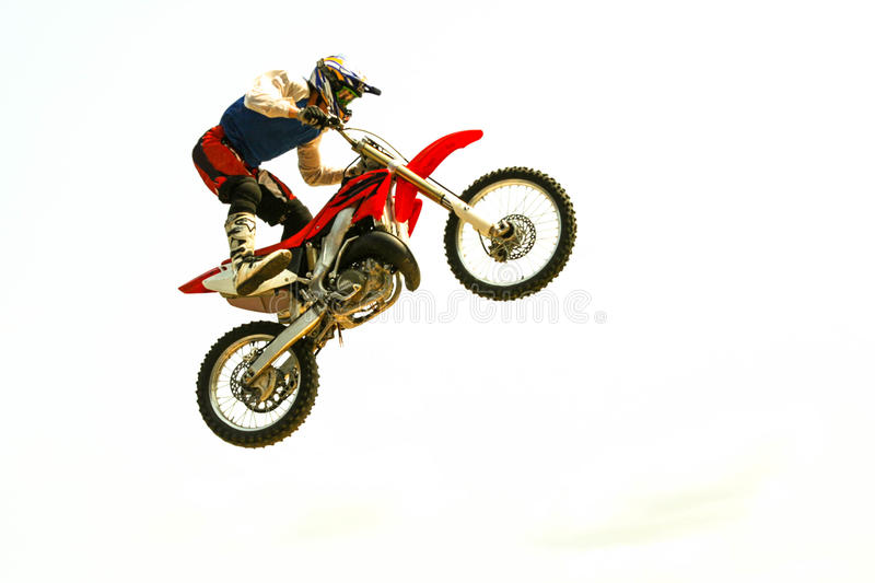 Motorcycle jump to the sky at trial show. Biker acrobatic jump at the trial show stock photography