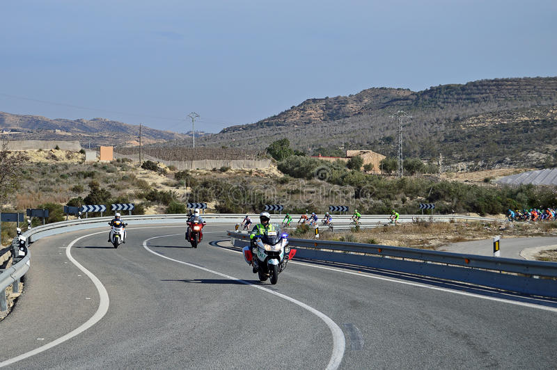 Motorcycle Leads A Cycle Race. The leaders follow a police BMW motorcycle during stage 4 of the 2016 Vuelta Valencia cycle race in Spain royalty free stock photography