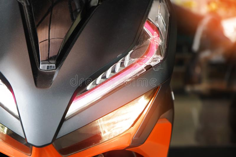 Motorcycle led headlight , broken headlight after the accident at motorcycle garage stock photos