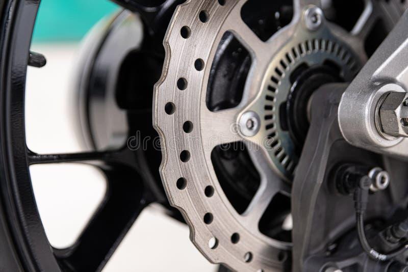 Motorcycle metal disk brake. Modern motorbike braking royalty free stock image