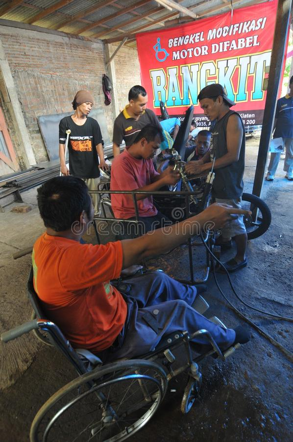 Motorcycle modification for people with disabilities. Peoples with disabilities modify a motorcycle into a three-wheeler at a workshop in Klaten, Central Java royalty free stock photo