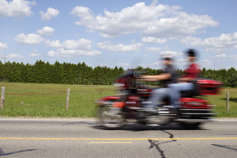 Motorcycle in motion royalty free stock photo