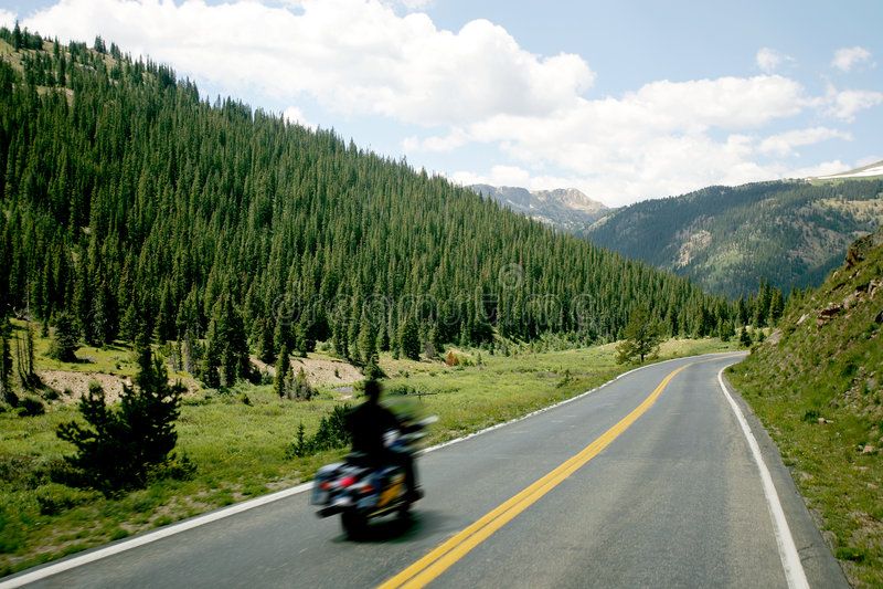 Motorcycle on Mountain Road stock photo