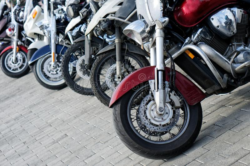 Motorcycle parking in the city. The problem of finding a parking space. Car rental. Moto sharing stock images