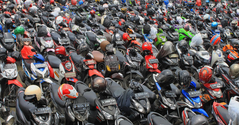 Motorcycle parking full a lot of motor parked outdoor, view on Jakarta Indonesia transportation royalty free stock photo