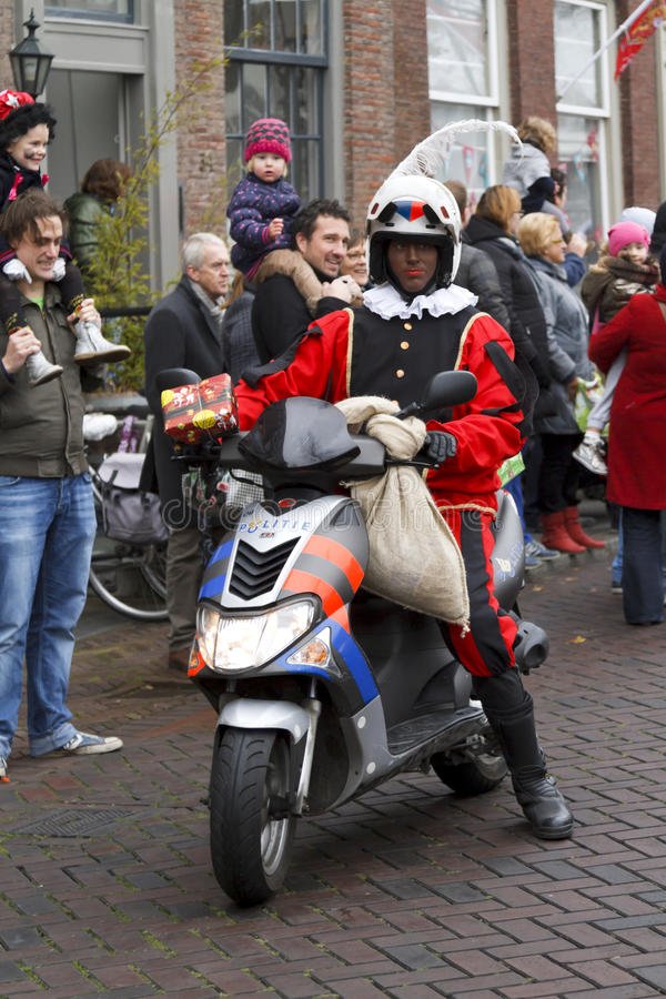 Motorcycle policeman dressed in costume. DORDRECHT, THE NETHERLANDS - NOVEMBER 17: Motorcycle policeman dressed in costume giving presents to the children on royalty free stock photography