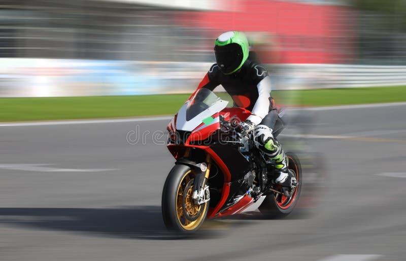 Motorcycle racer in helmet at high speed racing stock images