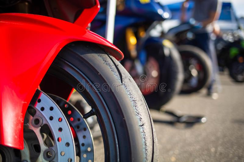 Motorcycle racing tire setup extreme sports close up. At day stock photography