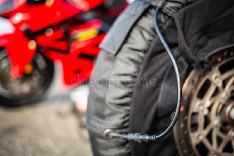 Motorcycle racing tire setup extreme sports close up. At day stock image