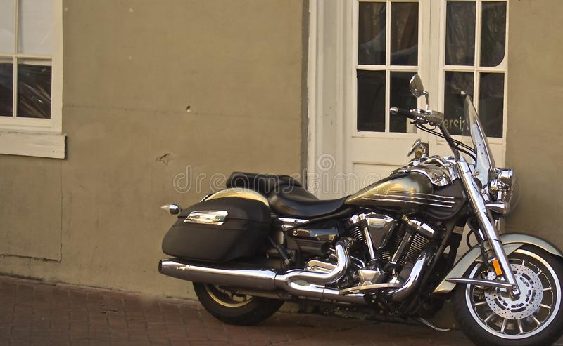 Motorcycle resting on a sidewalk in the French Quarter royalty free stock photography