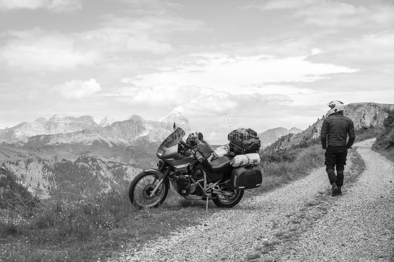Motorcycle rider enjoy the momment. Touring adventure motorbike on the top of mountain, enduro, off road, beautiful view, black. And white, freedom, extreme royalty free stock images