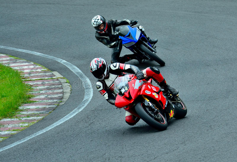 Motorcycle riding session on WallraV Race Center stock images
