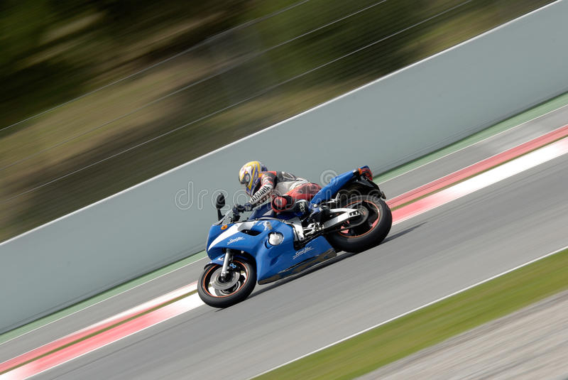 Download A Motorcycle Runs At Montmelo Circuit De Catalunya, A Motorsport Race Track Editorial Stock Image - Image of tournament, people: 31943609