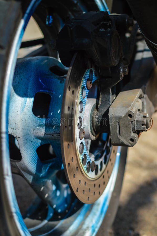 Motorcycle's back wheel and brake disc, closeup detail royalty free stock photos