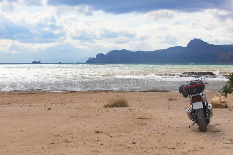 Motorcycle on a sandy beach royalty free stock image