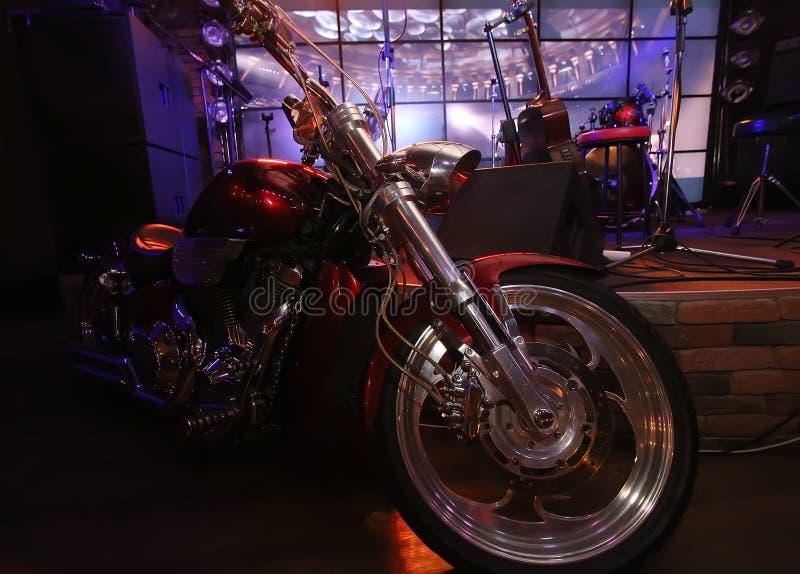 Motorcycle at scene of night bar royalty free stock image