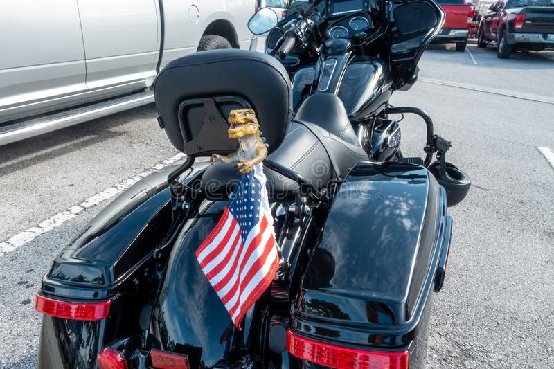 A motorcycle showing patriotism by flying a flag stock photography