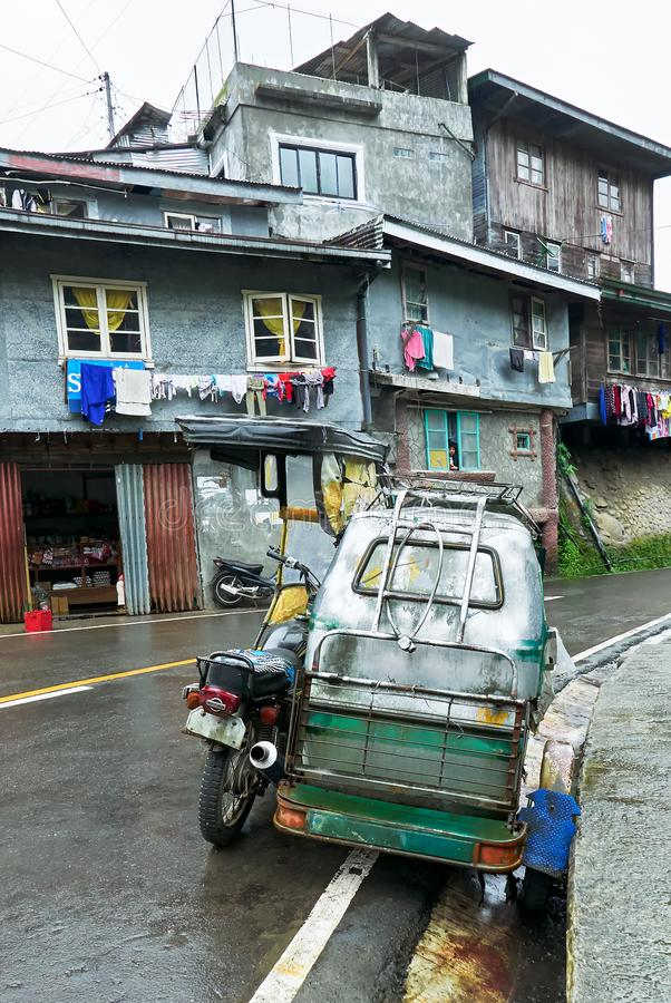 Motorcycle with sidecar at a road in Banaue, Philippines stock image