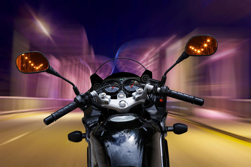 Motorcycle speeding at night. Motorcycle speeding in the highway at night. See isolated motorcycle version ID:58656784 complete with detailed clipping paths for royalty free stock photography