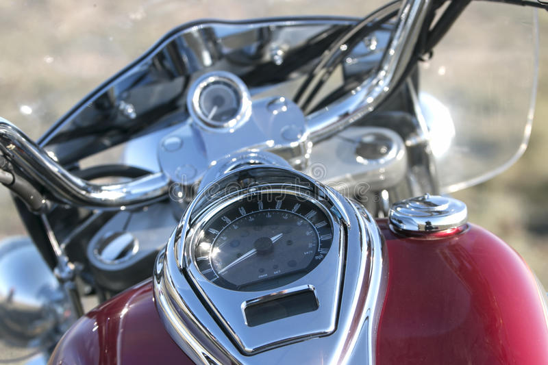 Motorcycle speedometer and odometer on a fuel tank stock photography
