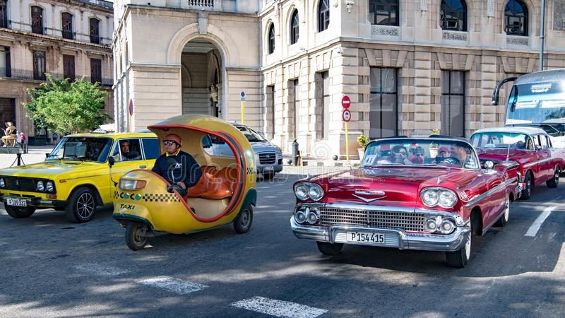 Motorcycle Taxi, american classic car Taxi, passenger transportation opportunities in Cuba royalty free stock images