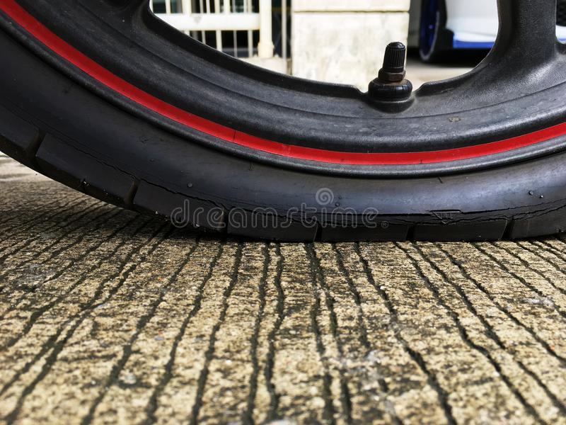 Motorcycle tire is broken. Motorcycle tire is broken in Thailand stock image