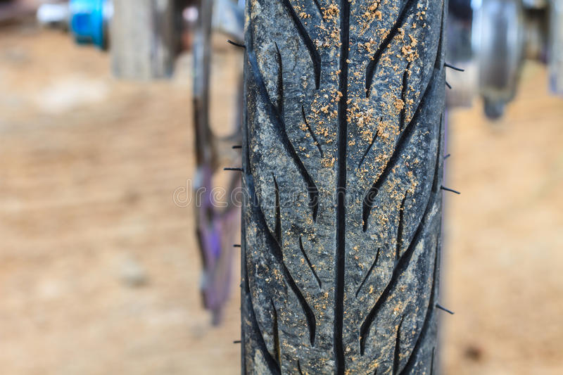 Motorcycle tire. Close up shot of motorcycle tire on road stock image