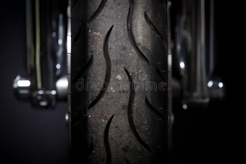 Motorcycle tire. Color shot of a motorcycle forks and tire royalty free stock images