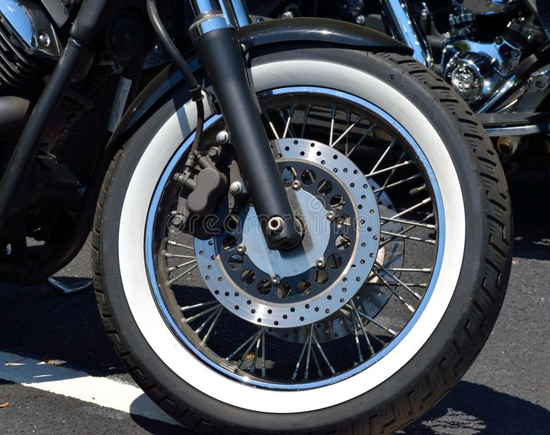 Motorcycle tire with disc brake. A close up of a motorcycle tire with a disc brake stock photo