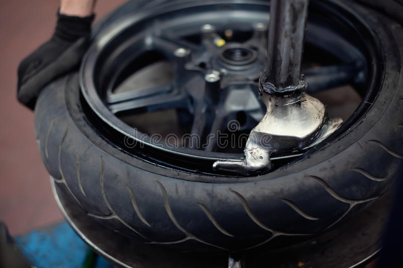 Motorcycle tire repair. By mechanic royalty free stock photography