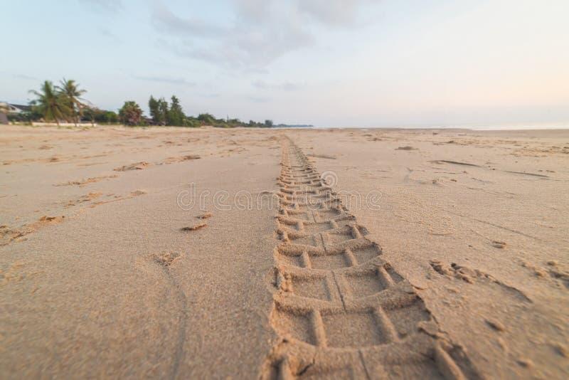 Motorcycle tire tracks on the beach. Closeup Motorcycle tire tracks on the beach royalty free stock photo