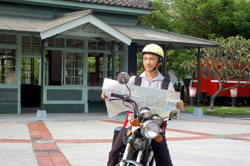 Download The Motorcycle Traveler Front Train Station Royalty Free Stock Images - Image: 21276249