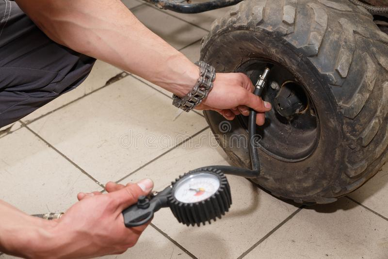 Motorcycle wheel repair after tire leaks or disc damage. Modification of certain parts of a motorcycle when it is used for a certain period of time by an royalty free stock photo