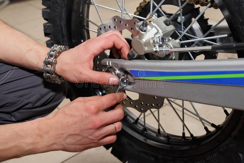 Motorcycle wheel repair after tire leaks or disc damage. Modification of certain parts of a motorcycle when it is used for a certain period of time by an stock photography