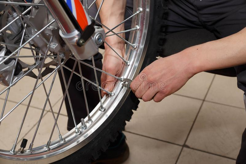 Motorcycle wheel repair after tire leaks or disc damage. Modification of certain parts of a motorcycle when it is used for a certain period of time by an stock photos