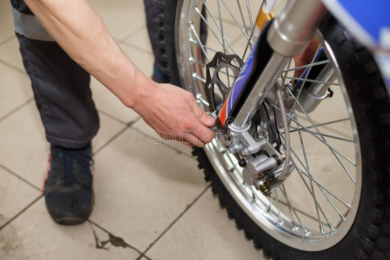 Motorcycle wheel repair after tire leaks or disc damage. Modification of certain parts of a motorcycle when it is used for a certain period of time by an royalty free stock photography