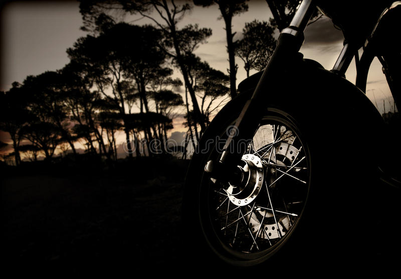 Motorcycle wheel on sunset royalty free stock photography