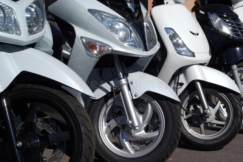 Motorcycles. Close up of motorcycles in a row stock photo