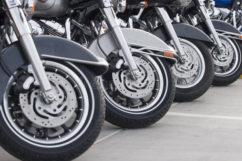 Motorcycles. In a row making a pattern royalty free stock photo