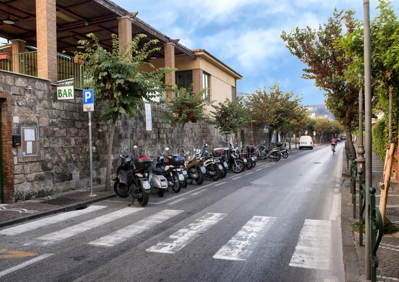 Motorcycles parked on a narrow street in Sorrento, Italy. Pictured are motorcycles parked on a narrow street in Sorrento, Italy. The motorcycle is a popular mode royalty free stock image