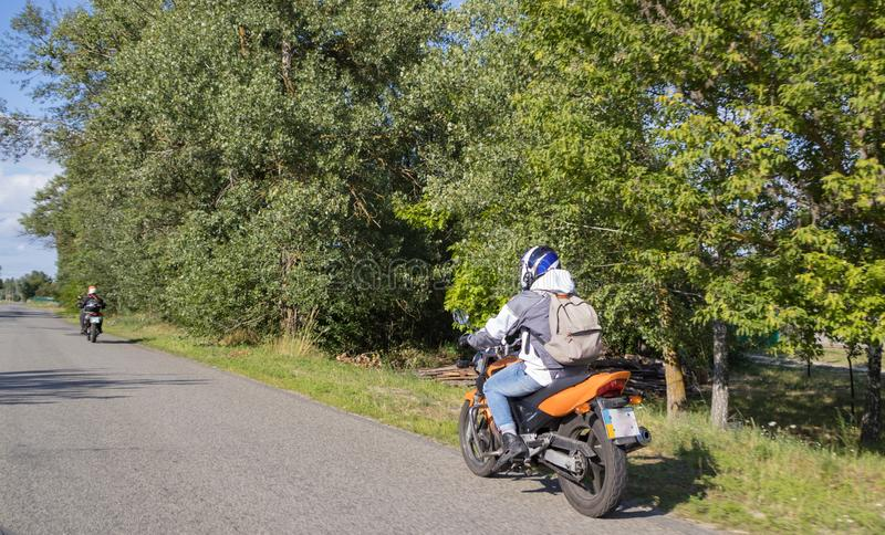 Motorcyclist biker driving on the highway royalty free stock photo
